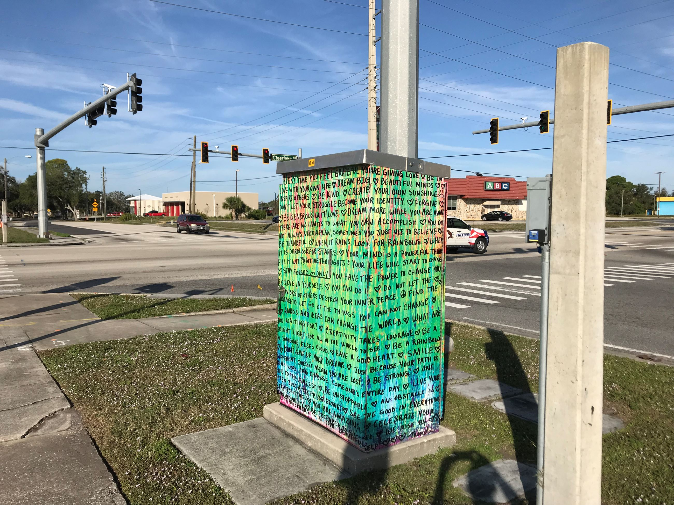 Photo of Positive Words Artwork on Traffic Box at Dixon Blvd. and Clearlake Rd.