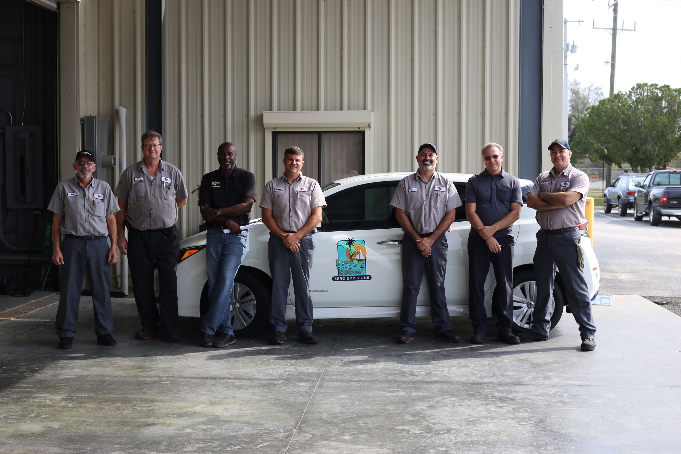 Cocoa's Fleet team in front of the first ever city electric vehicle