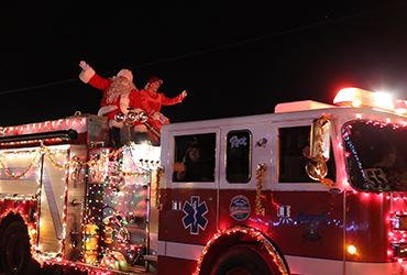 Christmas parade with Mr. and  Mrs. Claus on the fire truck